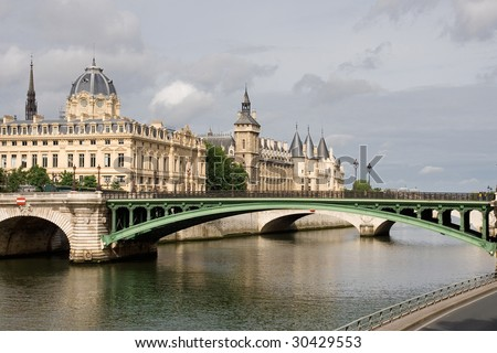 Paris bridge over river seine - stock photo