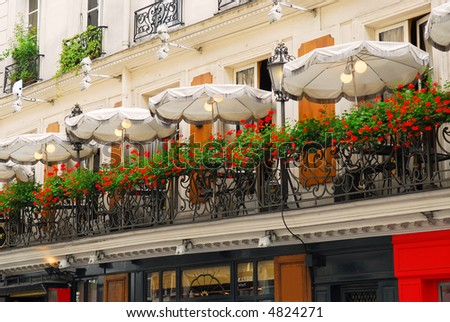 Paris cafe with a balcony patio and umbrellas stock photo for The balcony cafe