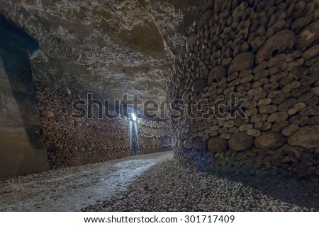 Paris Catacombs Skulls and bones walls detail  - stock photo