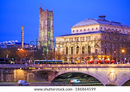 Paris center by night with Chatelet Theatre and Saint Jacques tower - stock photo