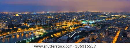 Paris city skyline rooftop view with River Seine at night, France. - stock photo