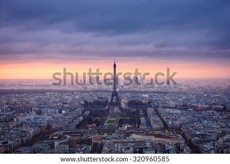 Paris cityscape clad in pink at dusk. Aerial view of Paris and its famous monuments and sites such as Eiffel Tower, Champ de Mars, Grand Palais, Trocadero, Palais de Chaillot, and La Defense. - stock photo