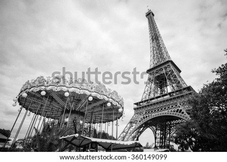 PARIS, Cityscape of Paris at the end of December on 30, 2015 in Paris. The Eiffel tower stands 324 metres (1,063 ft) tall. Monument was built in 1889. Black and white. - stock photo