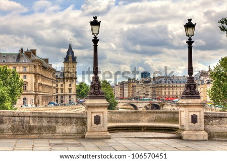 Paris cityscape. View from famous Pont Neuf with traditional lamppost. France. - stock photo