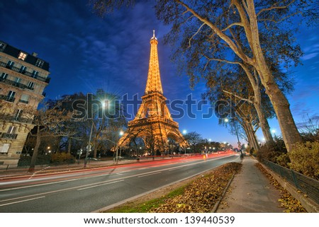 PARIS - DEC 1 : Eiffel tower at night, December 1, 2012 in Paris. The tower is the tallest structure in Paris and the most-visited paid monument in the world; 7.1 million people ascended it in 2011. - stock photo