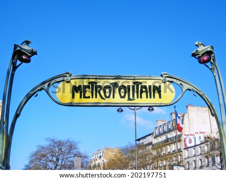 PARIS - DEC 25, 2008 -  Famous historic Art Nouveau entrance sign for the Metropolitain underground railway system. The metro transports annually millions of inhabitants and tourists. - stock photo