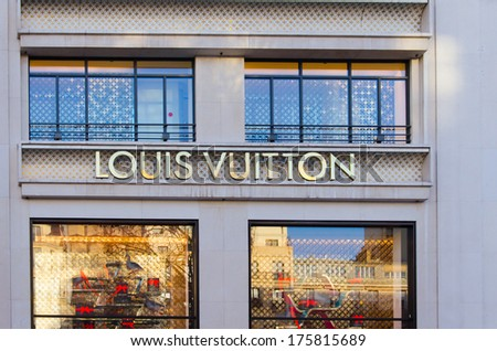 PARIS - DEC 26: Louis Vuitton store on the Champs-Elysees in Paris, France on December 26, 2013 - stock photo