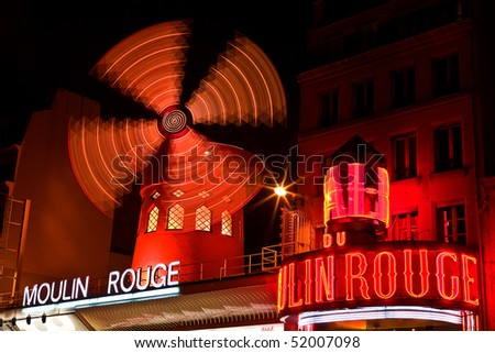 PARIS - DEC 9: The Moulin Rouge has been a favorite destination for tourists, locals, and celebrity performances since its opening in 1889. Paris, France, December 9, 2008. - stock photo