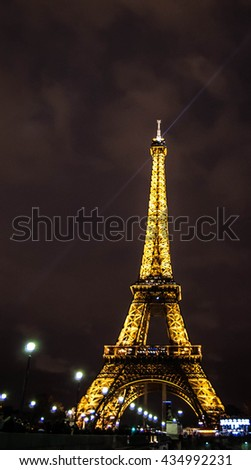 PARIS - DECEMBER 29: Eiffel Tower as seen at night on December 29, 2012 in Paris, France. The Eiffel tower is the most visited paid monument in the world with over 7 million visitors a year. - stock photo
