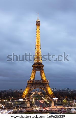 PARIS - DECEMBER 27: Eiffel Tower at dusk from Trocadero on December 27, 2013 in Paris. The Eiffel tower is the most visited monument of France with about 6 million visitors every year. - stock photo