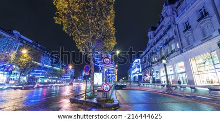 PARIS - DECEMBER 2, 2012: Lights of Champs Elysees at night. The famous avenue has a particular illumination during Christmas time.