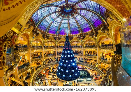 PARIS - DECEMBER 07: The Christmas tree at Galeries Lafayette on December 07, 2012, Paris, France.  The Galeries Lafayette has been selling luxury goods since 1895. - stock photo