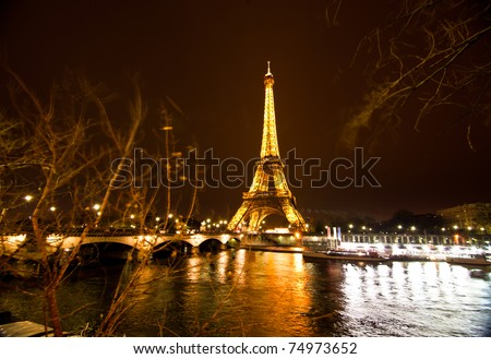 PARIS - DECEMBER 2: the Eiffel tower on  DECEMBER 2, 2010 in Paris, France. Built in 1889, it has become both a global icon of France and one of the most recognizable structures in the world. - stock photo
