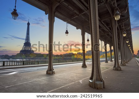 Paris. Eiffel Tower and Bir Hakeim Bridge in Paris, France during sunrise. - stock photo