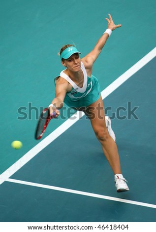 PARIS - FEBRUARY 10: Elena DEMENTIEVA of Russia returns the ball  during GDF Suez Open 2nd round match on February 10, 2010 in Paris, France - stock photo