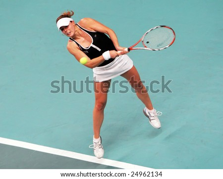 PARIS - FEBRUARY 13: French tennis player Alize Cornet returns the ball during quarter final match at Open GDF SUEZ WTA tournament, Pierre de Coubertin stadium on February 13, 2009 in Paris, France.