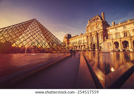 PARIS - FEBRUARY 7, 2015: Louvre Museum at sunset on February 7, 2015 in Paris. The Louvre Museum is one of the world's largest museums, a historic monument and a central landmark of Paris. - stock photo