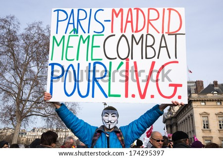 "PARIS - FEBRUARY 1, 2014: Man holds a panel with the inscription: ""Paris-Madrid, same combat, for the voluntary termination of pregnancy"". Protesters marched against the new abortion law in Spain."