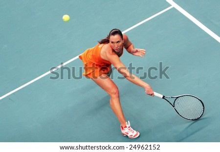 PARIS - FEBRUARY 13: Serbia's Jelena Jankovic returns the ball during her quarter final match at Open GDF SUEZ WTA tournament, Pierre de Coubertin stadium on February 13, 2009 in Paris, France.