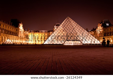 PARIS - FEBRUARY 28: the glass pyramid at Louvre on February 28, 2009 in Paris. - stock photo