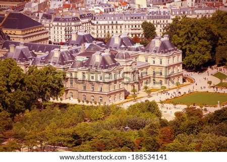 Paris, France - aerial city view with Luxembourg Palace. UNESCO World Heritage Site. Cross processed colors style - filtered tone retro image. - stock photo