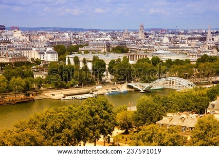 Paris, France - aerial city view with Seine River and Debilly footbridge. UNESCO World Heritage Site. Filtered style colors. - stock photo
