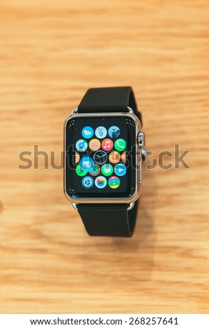 PARIS, FRANCE -  APR 10, 2014: New wearable Apple Watch smartwatch displaying the new interface home screen. Apple Watch incorporates fitness tracking and health-oriented capabilities with iOS - stock photo
