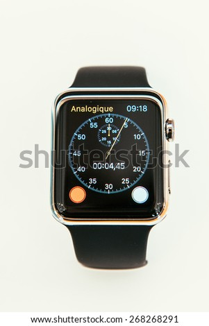 PARIS, FRANCE -  APR 10, 2015: New wearable computer Apple Watch smartwatch displaying the new Chronometer App. Apple Watch has an integration with iOS Apple products and services - stock photo