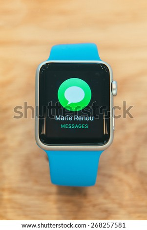 PARIS, FRANCE - APR 10, 2015: New wearable computer Apple Watch smartwatch displaying the Watch collection. Apple Watch incorporates fitness tracking and health-oriented capabilities with iOS - stock photo