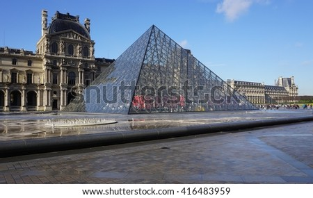 PARIS, FRANCE -11 APRIL 2016- Built in 1989, the Pyramide du Louvre is a glass pyramid designed by architect I. M. Pei in the Cour Napoleon main courtyard in the Louvre Museum in Paris. - stock photo