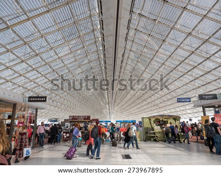 PARIS, FRANCE - APRIL 10, 2015: Departure gates inside Charles de Gaulle airport, the France's largest airport. In 2013, the airport handled 62,052,917 passengers and 497,763 aircraft movements. - stock photo