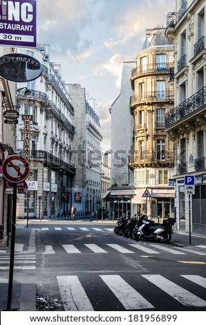 PARIS, FRANCE - APRIL 07: Early morning, first rays of the sun touch the streets of Paris on April 07, 2013 in Paris, France - stock photo
