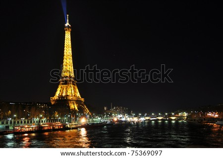 PARIS, FRANCE- APRIL 4: Eiffel tower at night. The Eiffel tower is the most visited monument of France. April 4, 2010, Paris