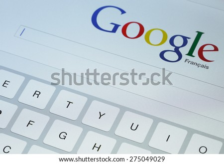 Paris, France - April 27, 2015: Google search page on screen of ipad - stock photo