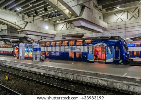 PARIS, FRANCE - APRIL 25, 2015: Interior of Montparnasse railway station. Gare Montparnasse (1840) is one of six large Paris railway termini. It is used by intercity TGV trains and regional services.