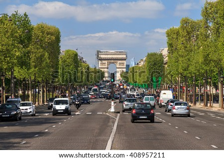PARIS, FRANCE - APRIL 14, 2014: Lots of traffic on a normal spring day at the Champs-Elysees in Paris, France, on April 14, 2014 - stock photo