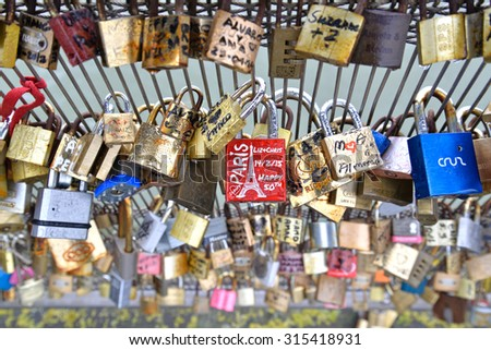 Paris, France- April 2, 2015: Many lovelocks left at Seine bridges by lovers from all around the world in Paris, France - stock photo