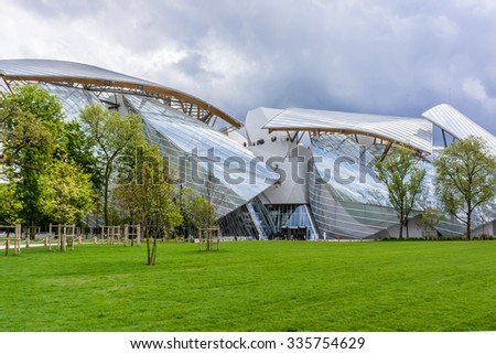 PARIS, FRANCE - APRIL 25, 2015: Modern architecture of Louis Vuitton Foundation (American architect Frank Gehry, 2014). Louis Vuitton Foundation is an art museum and cultural center. - stock photo