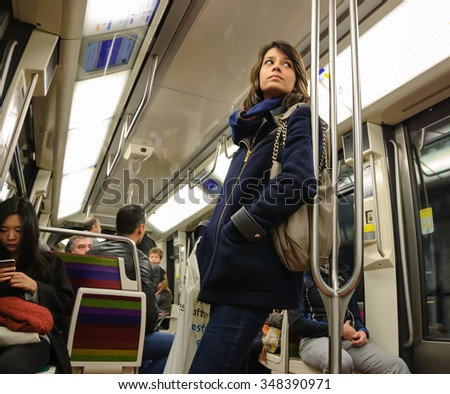 PARIS, FRANCE - APRIL 6, 2015: People in train of Line 1 in Parisian Metro. The Paris Metropolitain is serving over 1.5 billion passengers per year.