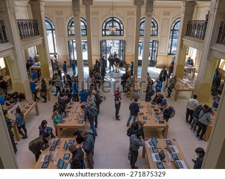 PARIS, FRANCE - APRIL 7, 2015: People inside Apple Store. As of 2014, Apple employs 72,800 permanent full-time employees, maintains 437 retail stores in fifteen countries. - stock photo