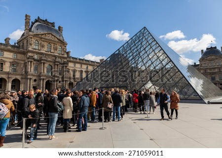 PARIS, FRANCE - APRIL 1, 2015: People Waiting in Long Queue at Louvre Museum on April 1, 2015 in Paris France - stock photo