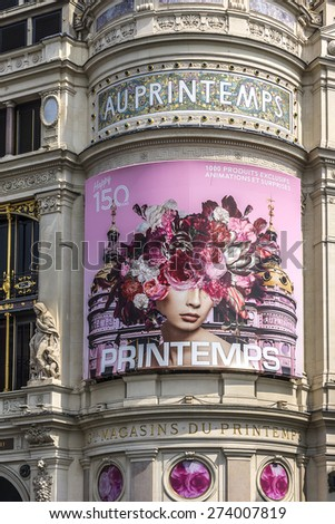 PARIS, FRANCE - APRIL 24, 2015: Printemps (founded in 1865) in Paris - largest beauty Department Store in world with 45000 square meters of shopping. Printemps facade (registered as Historic Monument) - stock photo