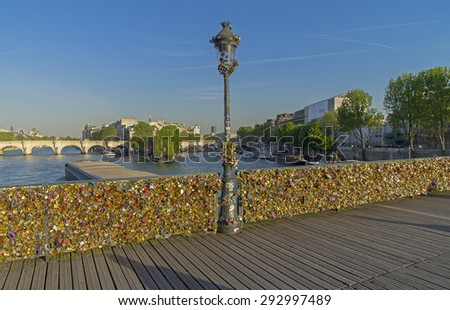 PARIS, FRANCE - APRIL 9, 2014: Railing of the bridge, completely hung with locks of love. Pedestrian Arts bridge over the Seine in Paris. - stock photo