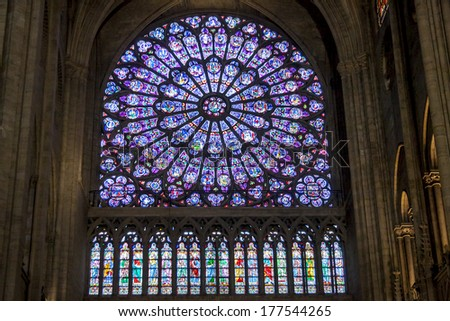 PARIS, FRANCE -  APRIL 26: Rose window at Cathedral Notre Dame de Paris on april 26, 2013 in Paris.The cathedral of Notre Dame is one of the top tourist destinations in Paris. - stock photo