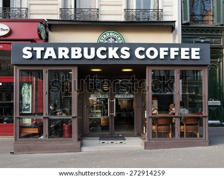 PARIS, FRANCE - APRIL 7, 2015: Starbucks Coffeehouse shop on the street. Starbucks is the largest coffeehouse company in the world, with 21,536 stores in 64 countries and territories. - stock photo