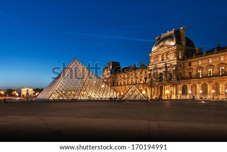 PARIS, FRANCE-APRIL 14: The large glass pyramid and the main courtyard of the Louvre Museum on April 14, 2013. The Louvre Museum is one of the largest museums of the world  - stock photo