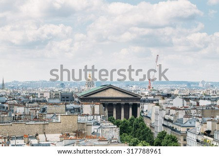 Paris, France - april 30, 2015: View of Paris from the roof of the shopping center printemps. One can see the rooftops of Paris and sights