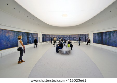 PARIS, FRANCE -12 APRIL 2016- Visitors admire the giant waterlily Nympheas paintings by impressionist painter Claude Monet at the Musee de l Orangerie museum in Paris. - stock photo