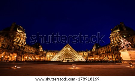 PARIS, FRANCE - AUG 8, 2013 : Louvre museum at twilight in summer. Louvre museum is one of the world's largest museums with more than 8 million visitors each year. - stock photo