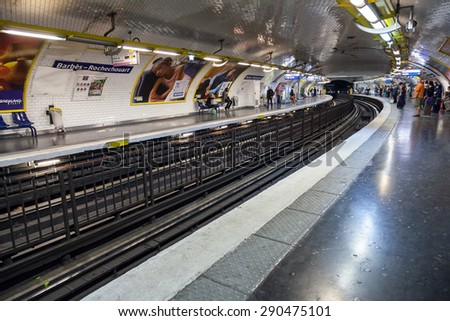 Paris, France - August 9, 2014: Barbes-Rochechouart. Parisian subway station with passengers - stock photo